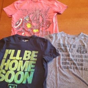 Three t shirts that are all youth small